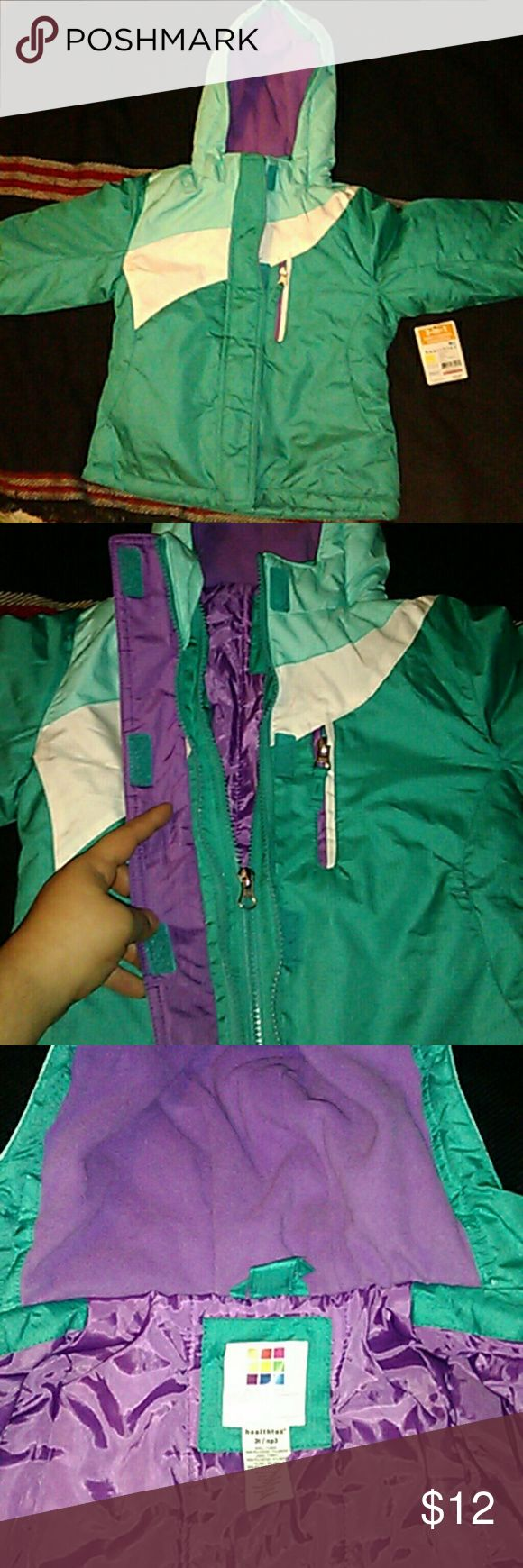 Girls Healthtex Water Resistant Jacket Brand new cute teal, white, and purple water resistant jacket. Has two front pockets and one pocket on chest. Adjustable hems on sleeve. This jacket had an inner jacket, but that part is gone. BUNDLE DISCOUNTS!! Healthtex Jackets & Coats