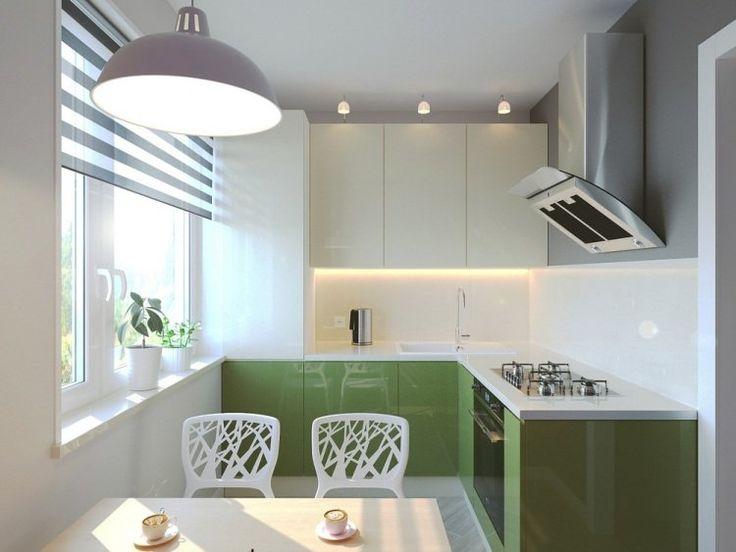 meubles de cuisine vert laqué, luminaire design et chaises blanc neige