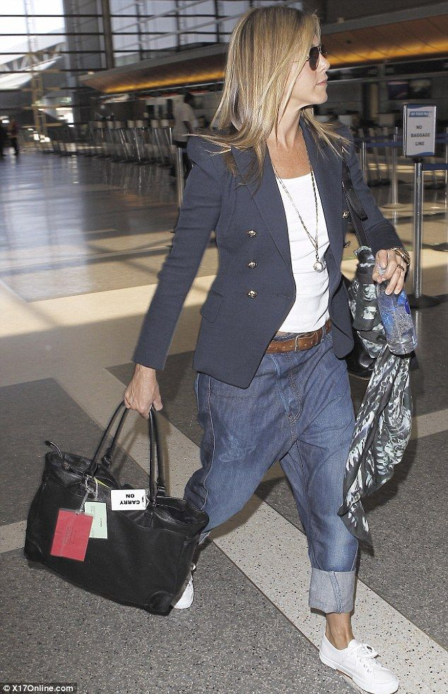 Taking style tips from MC Hammer? Jennifer Aniston, 43, attempts to roll back the years in a pair of unflattering baggy jeans
