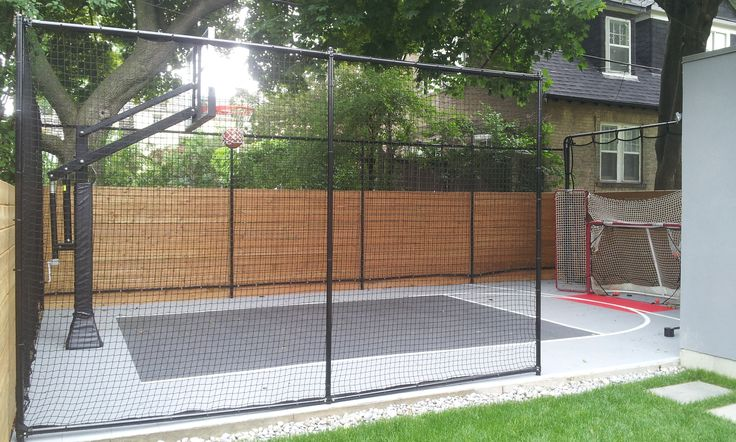 20x32 Backyard Court by Total Sport Solutions | Containment netting keeps the ball in play Court surface is DuraCourt from SnapSports installed on a concrete pad (Cool Places Pools)