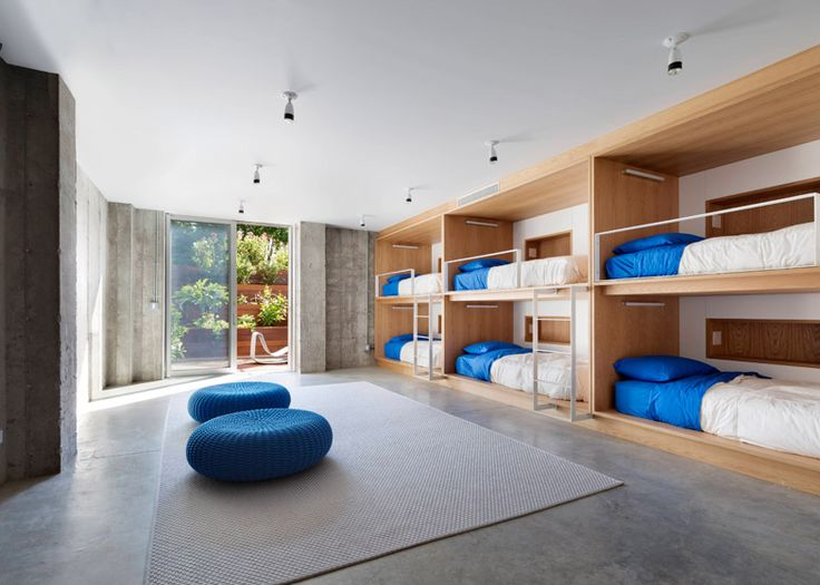 Guest bedrooms inside a three-pronged house in New York state.