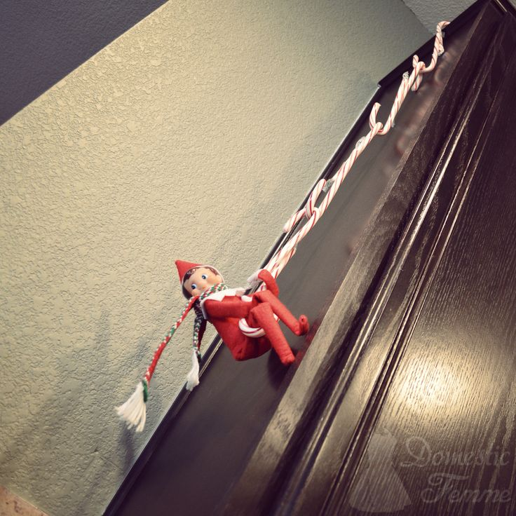 Candy Cane Rope Swing - Elf On The Shelf 2014 Calendar (25+ NEW Ideas!) w/ FREE Printables! #Nice #Naughty #Good #Bad #Boys #Girls #Printable #Planner #Picture #Pictures #Photo #Photos #Pets #Christmas #Holiday #Holidays #Traditions #Tradition #Elves #Activity #Activities #Puzzle #Puzzles #Word #Search #Food #Top #Best #Cheap #Fast #All #Time #Funny #Hilarious #Kids #Mischievous #Mischief #Pranks #Xmas #Magic #Kids #Toddlers #Quick #Easy #Younger #Older #Arrival #Hiding #Departure #Christian…