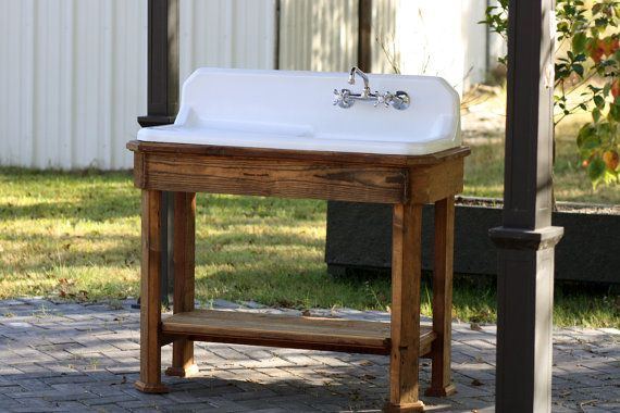 Refinished High Back Drainboard Cast Iron Porcelain Sink Reclaimed Wood Long Leaf Pine Stand New Faucet & Drain The farmhouse sink refinished to