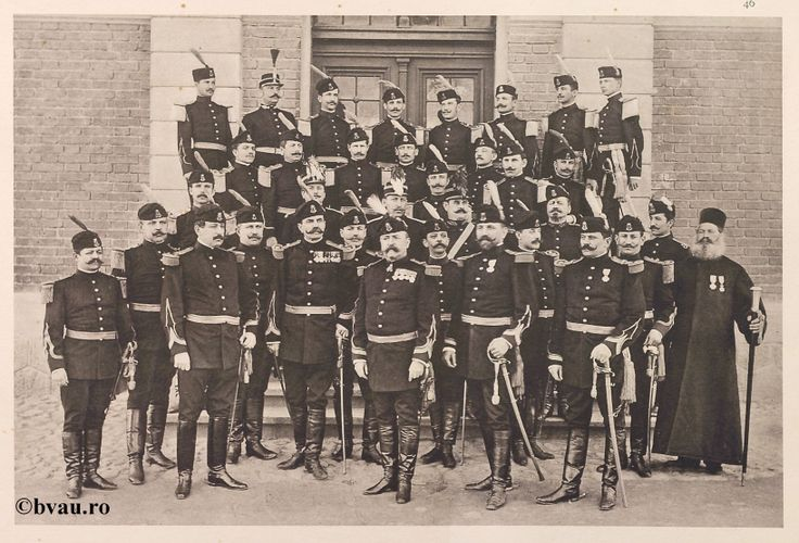 "Regimentul Gorjiu nr. 18, 1902, Romania. Ilustrație din colecțiile Bibliotecii Județene ""V.A. Urechia"" Galați. http://stone.bvau.ro:8282/greenstone/cgi-bin/library.cgi?e=d-01000-00---off-0fotograf--00-1----0-10-0---0---0direct-10---4-------0-1l--11-en-50---20-about---00-3-1-00-0-0-11-1-0utfZz-8-00&a=d&c=fotograf&cl=CL1.11&d=J047_697980"