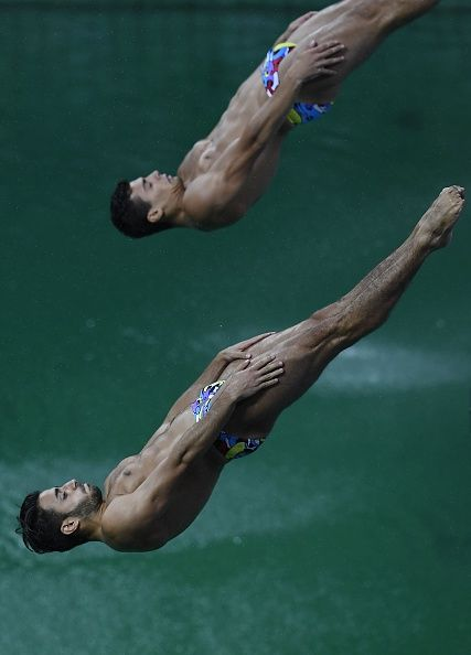 #RIO2016 Italy's Andrea Chiarabini and Italy's Giovanni Tocci compete in the Men's Synchronised 3m Springboard Final during the diving event at the Rio 2016...