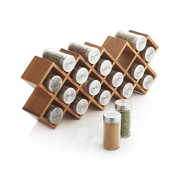 Acacia wood crisscrosses a spice rack in a three-in-one design that can stand on its own, be mounted on the wall or tucked into a drawer. Occupying the nooks are 18 glass jars filled with savory spices and outfitted with stainless steel caps and sifter disks for easy dispensing.
