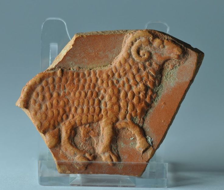 Roman terra sigillata plate fragment with sheep, 4th-5th century A.D. African red slip ware plate fragment, North Africa, with sheep, 8 cm high. Private collection