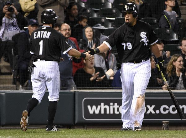 Jose Abreu Photos Photos - Adam Eaton #1 of the Chicago White Sox is greeted by Jose Abreu #79 after scoring against the Minnesota Twins during the fourth inning on September 30, 2016 at U. S. Cellular Field in Chicago, Illinois. - Minnesota Twins v Chicago White Sox