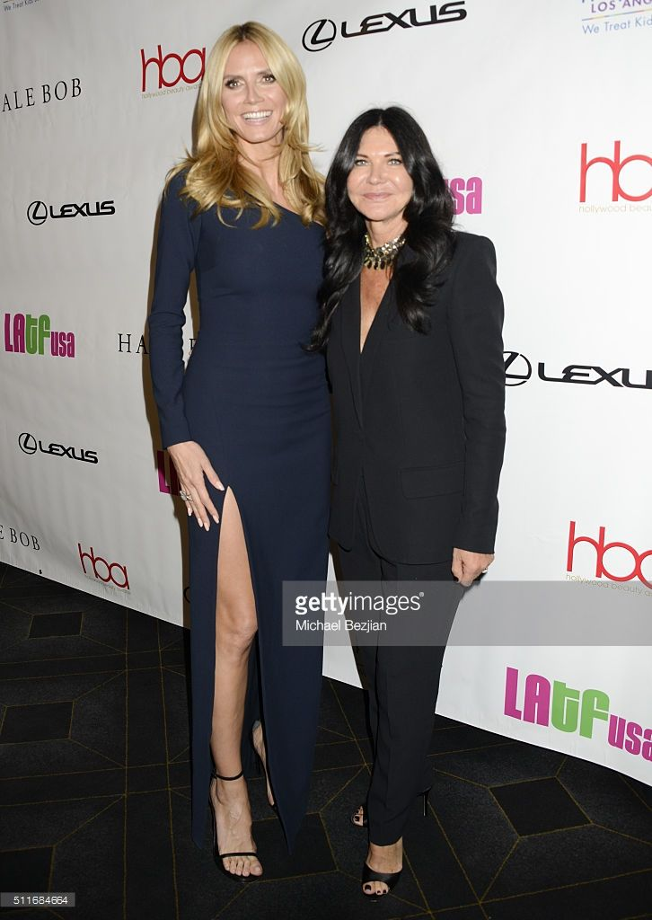 Model and business magnate Heidi Klum (L) and hair stylist Wendy Iles arrive at the 2nd Annual Hollywood Beauty Awards Benefiting Children's Hospital Los Angeles at Avalon Hollywood on February 21, 2016 in Los Angeles, California.