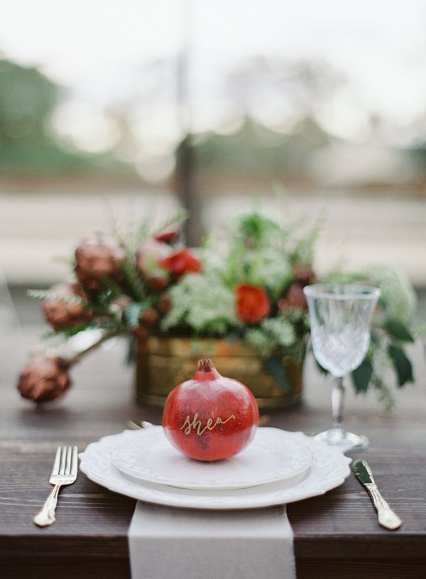 pomegranate + calligraphy = instant place card // photo by Melanie Gabrielle // http://ruffledblog.com/woodsy-winter-dinner-party