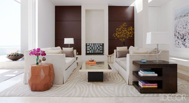 In the living room of a Los Angeles home designed by Chad Eisner, walnut panels line the back walls.
