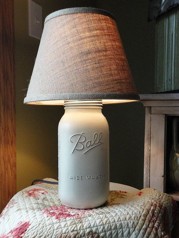 This table lamp is made from a half gallon mason jar. Lamps are painted color of your choice, distressed and sealed. Clean with a soft cloth as