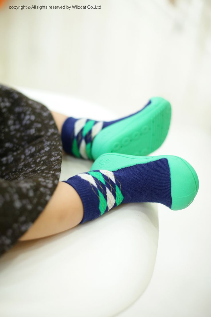 Light as a sock but more supportive than a pre-walker! Choose from Argyle Navy or Argyle Green