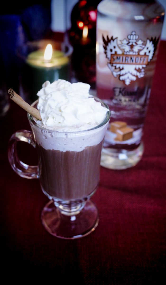 Texan Hot Cocoa drink recipe: 1 oz SMIRNOFF® Kissed Caramel® Flavored Vodka, 5 oz spicy hot cocoa. Heat over medium-high heat. Pour into mug. Garnish with whipped cream and grated cinnamon. I wish I was 21 :(