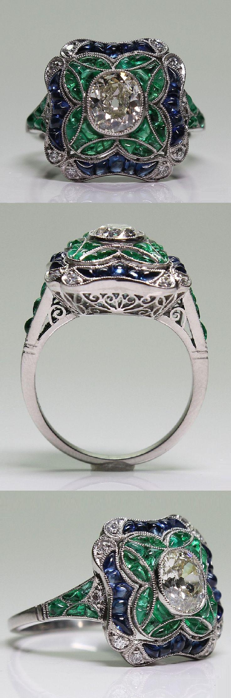 An Art Deco platinum, diamond, sapphire and emerald ring, 1920-35. #ArtDeco #ring