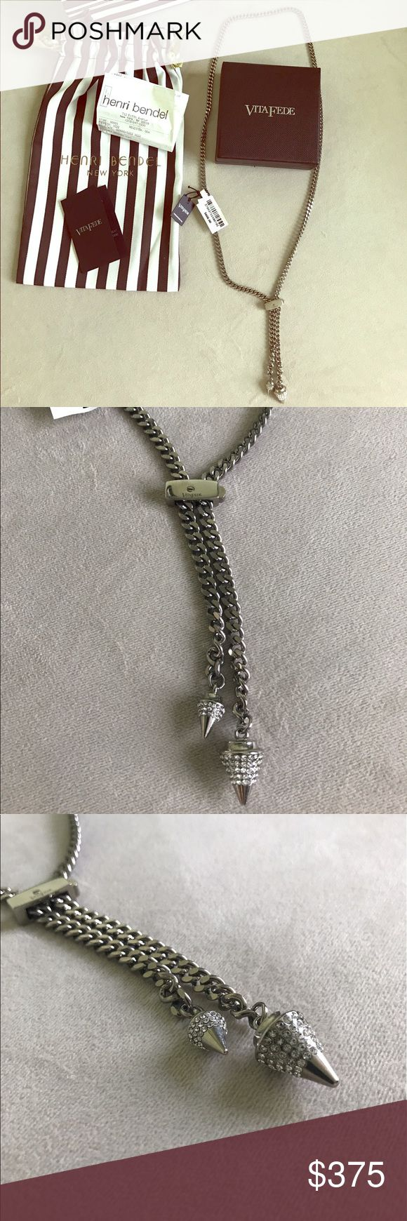 Vida Fede Silver Titan Crystal Arrow Necklace Purchased from Henri Bendel in NYC on 5th Avenue. It was a display item which they marked down to $508 + tax, so I purchased it and just never wore it. Retail is $608 + tax. Swarovski Crystal on arrows.  It's in perfect condition besides microscopic wear from people trying it on (it doesn't even show in photos and can't be seen easily).   Comes with original tags, box, receipt, bags, card. Vita Fede Jewelry Necklaces