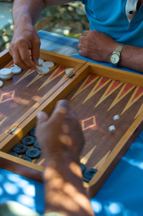 Elderly men playing backgammon Egiali Amorgos Island Greek Islands Greece