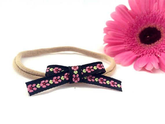 These handmade ribbon bows are the perfect accessory for babies and children all year round. The floral pattern is perfect for all the boho babes of Australia, while the soft nylon is super stretchy and will not leave marks on delicate baby skin.  These bows are approximately 5.5cm x 2cm The headband will stretch to fit up to an older child.  Product Safety All young children should never be left unattended or left to sleep wearing any sort of headband or hair accessory. Please ensure…