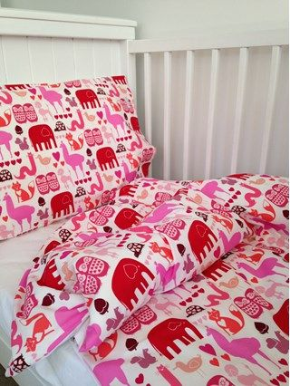 Red and pink animals cot duvet cover. 100% cotton. Perfect for a nursery. Made in New Zealand. www.lovefromfriday.co.nz