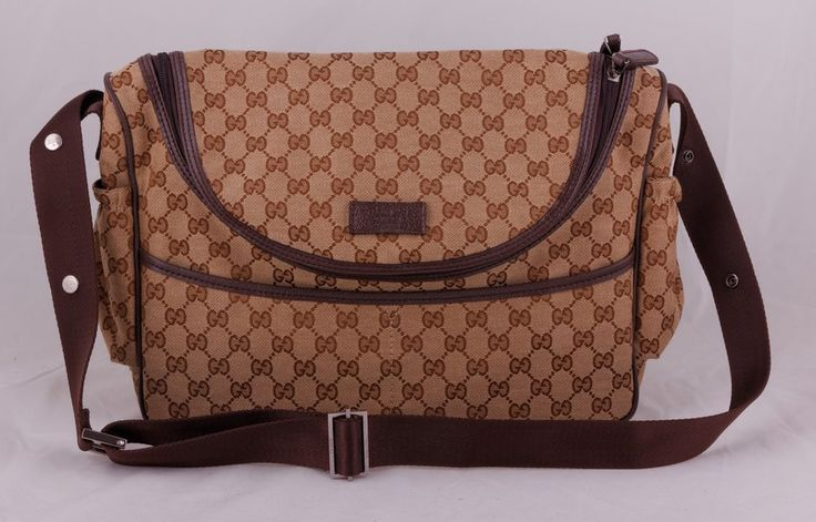 Cумка Gucci (Гуччи) из фирменного материала и элементов из натуральной кожи