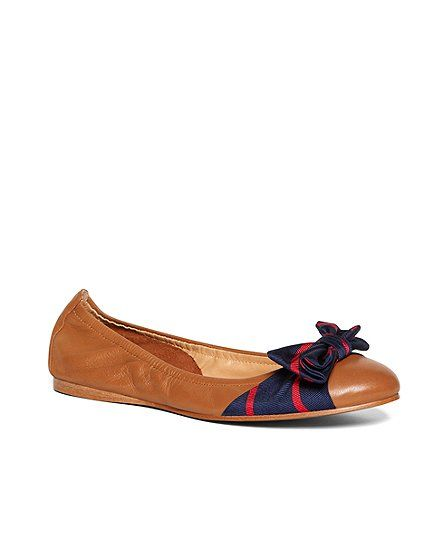 Bow Ballet Flats crafted in calfskin accented with a silk twill bow. Fully leather lined and padded sock. Leather sole. Imported.