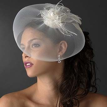 The runway was featuring beautiful bridal cocktail hats as an alternative to wearing a wedding veil. Love this one. Available in white or ivory. $72.95  http://www.weddingaccents.com/accessories/Hats-Bridal--Cocktail-p-1-c-344.htm