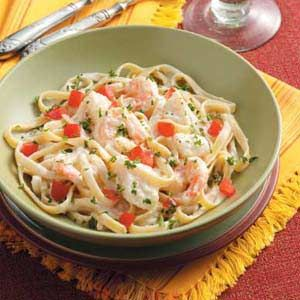 Seafood Fettuccine Alfredo Recipe -I like to serve this lovely pasta, featuring scallops and shrimp, with crusty Italian bread. Sprinkled with tomato and parsley, this dish looks as mouthwatering as it tastes. —Jimmy Spellings, Oakland, Tennessee