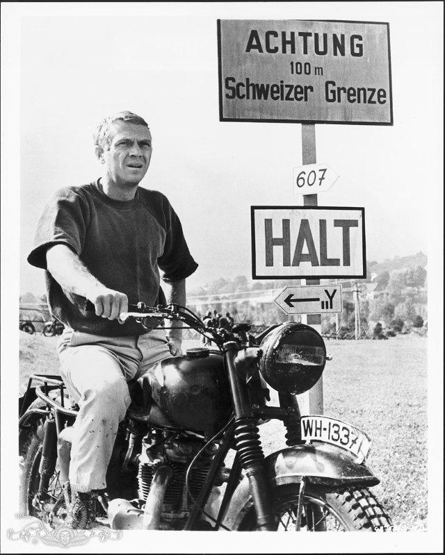 Steve McQueen, The Great Escape, 1963. A movie fact from iMDb: During the climatic motorcycle chase, John Sturges allowed Steve McQueen to ride (in disguise) as one of the pursuing German soldiers, so that in the final sequence, through the magic of editing, he's actually chasing himself.