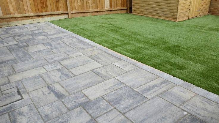 Historic Flag Slate paving, natural paving with a modern design and with Namgrass Enigma artificial grass too. Makes a stunning and user friendly garden all year round. Supplied and installed by Mango Paving & Landscaping Ltd.