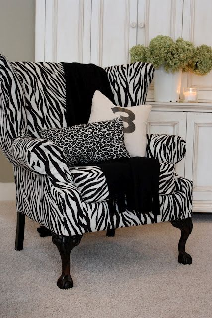Reupholstered armchair in zebra print.
