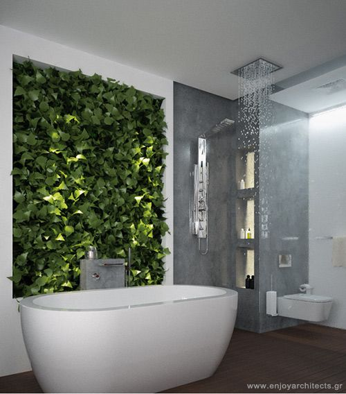 luxurius bathtub with green wall in a small hotel room by enjoy architects