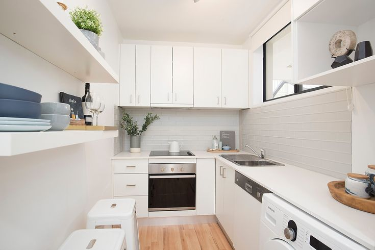 'Harbour Views' apartment with parking, modern kitchen, dishwasher, washing machine, styled, stools, Pilcher Residential