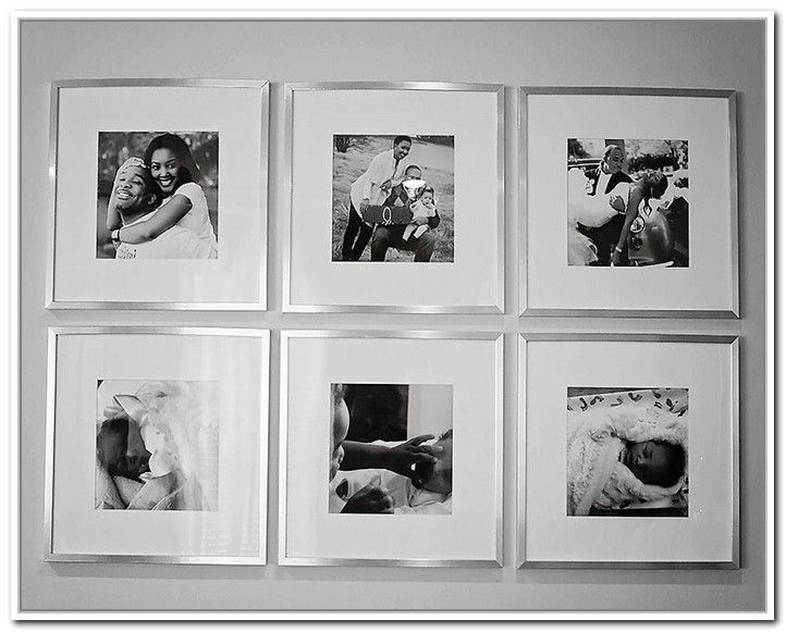 silver picture frames on wall with black and white family photos need to do this