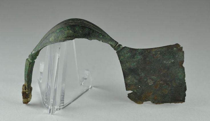 Greek bronze fibula Greek brooch, Attic Boeotian type, late Geometric period, 8th century B.C.  8th century B.C. 7.4 cm long and 4.9 cm high. Private collection