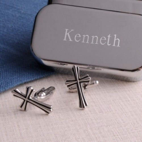"SILVER CROSS CUFFLINKS WITH PERSONALIZED CASE. Trimmed in black, these Silver Cross-shaped Cufflinks with Personalized Case are ideal for formal weddings, religious ceremonies, or even everyday wear. Great gift for groomsmen or anyone celebrating a religious occasion! Case measures 3"" x 1 1/8"" x 1 1/2"". Personalize the case with two lines of up to 15 characters per line."