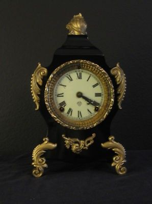 """For sale we have an Ansonia Calais Parlor clock. This clock is in excellent condition and was recently restored to original look. The clock is a """"time and strike"""" cathedral gong on the hour and half"""