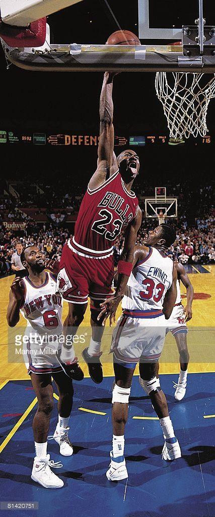playoffs, Chicago Bulls Michael Jordan (23) in action, making dunk vs New York Knicks Patrick Ewing (33) and Trent Tucker (6), New York, NY 5/16/1989
