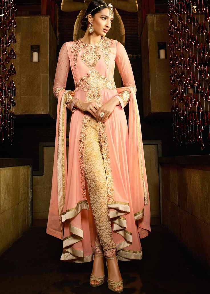 Pink Asymmetrical Kameez With Pant & Dupatta.The essential detailing of resham, zari and patch border work on the pink kameez allures a beautiful look. A crape inner, chiffon dupatta and georgette pants are also available
