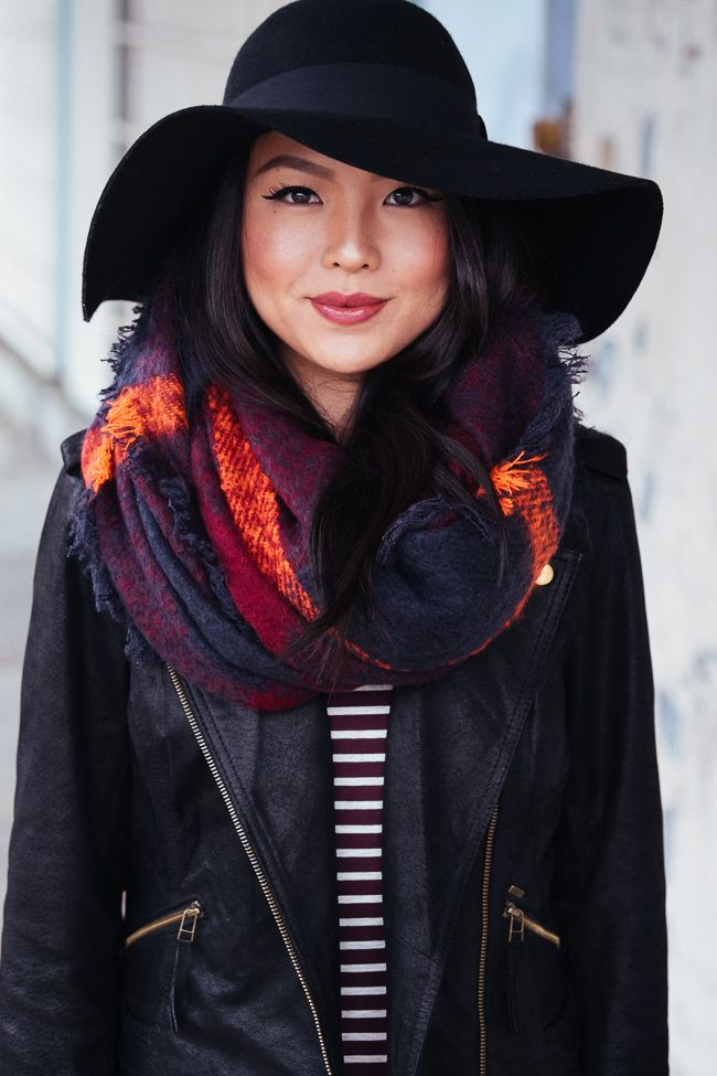Go glam for fall in a moto jacket, a jewel-toned scarf & a floppy wool hat.