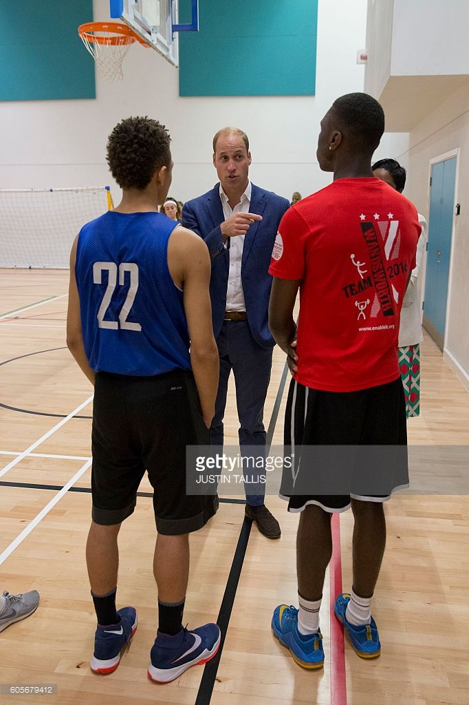 Britain's Prince William, Duke of Cambridge (C), meets of the basket ball team on a visit to Caius House Youth Centre in London on September 14, 2016. The youth charity Caius House aspires to bring the local community together by helping young people bridge the educational and life skills gap between childhood and adulthood. The Duke toured Caius's facilities and met with youth who use their services. / AFP / POOL / JUSTIN