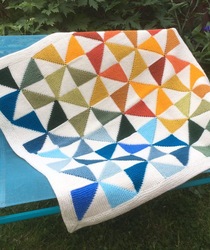 Free Knitting Pattern for Country Quilt Baby Blanket - Afghan of modular pinwheel blocks inspired by traditional quilt designs. Designed by Caron Design Team. Pictured project by Mootthing who did 4x4 blocks.