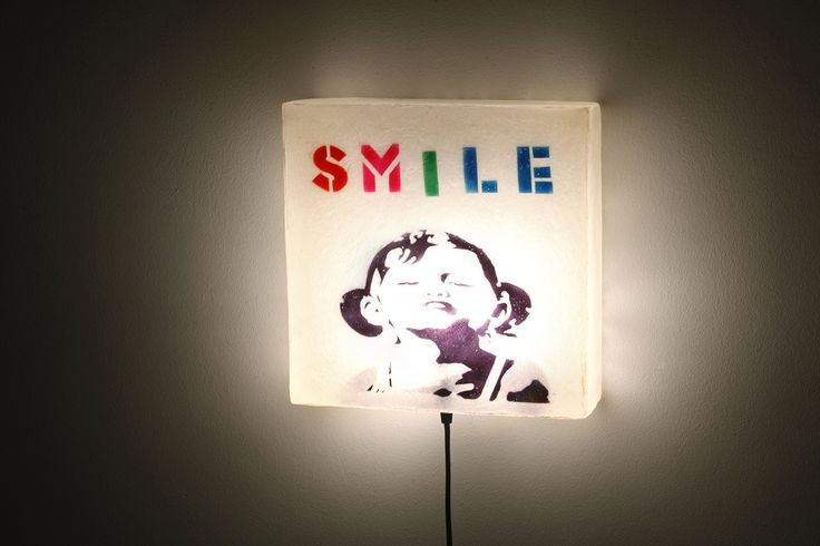 """""""Smile"""" design - This lamp has Natural White for its background and a multi color design. To view more pics, cut and paste the following link: http://gshopspot.gr/product.php?product_id=619"""