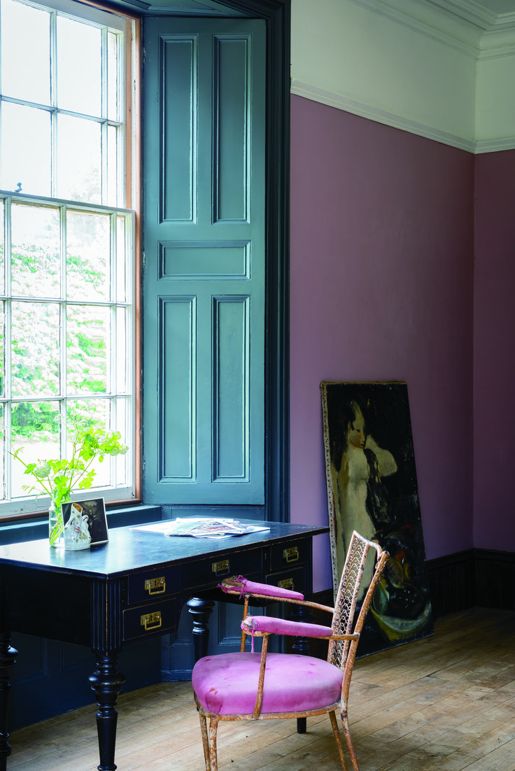 """Here, flat Cinder Rose walls contrast with woodwork painted in full gloss Railings. """"The full gloss bounces the light off the shutters and creates a traditional feel,"""" writes Studholme."""