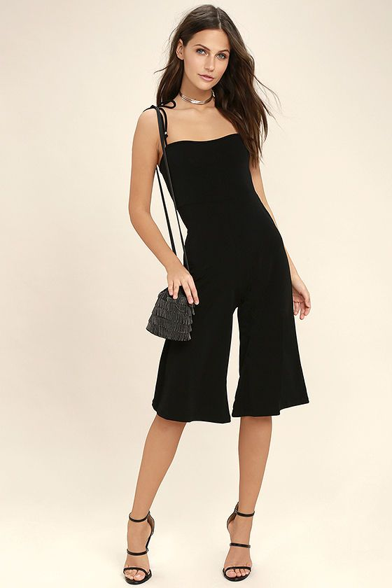 Go from fashion newbie to a style star with the Style Evolution Black Midi Jumpsuit! Adjustable, tying straps (with beaded ends) support this chic, stretch knit jumpsuit with a square neckline, high-waisted fit, and wide pant legs that end at a midi length.