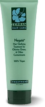 Negate, from Zerran.   Designed to remove and eliminate chlorine green, cosmetic coatings, trace metals, medication and salts from hair while adding sheen and manageability. Use before swimming to prevent green hair! My number One seller during pool season