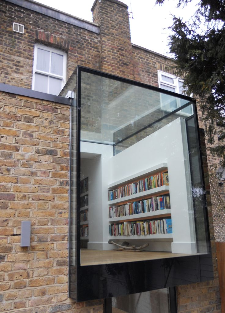 Lots of natural reading light: structural glass box becomes the library.
