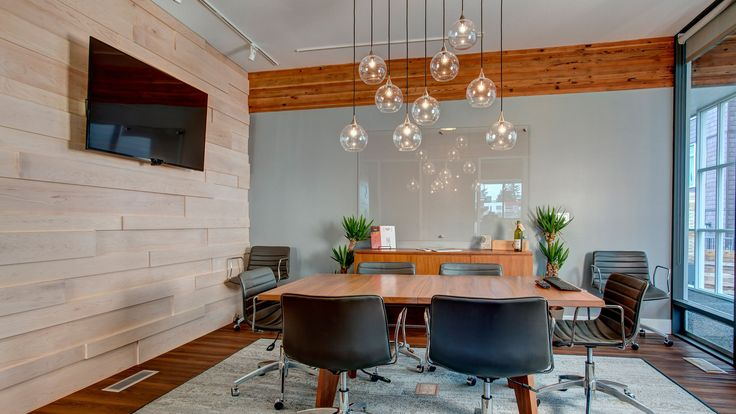 This commercial office design project for a boutique real estate firm remodeled a great mid-century commercial building, adding a Pacific Northwest touch.