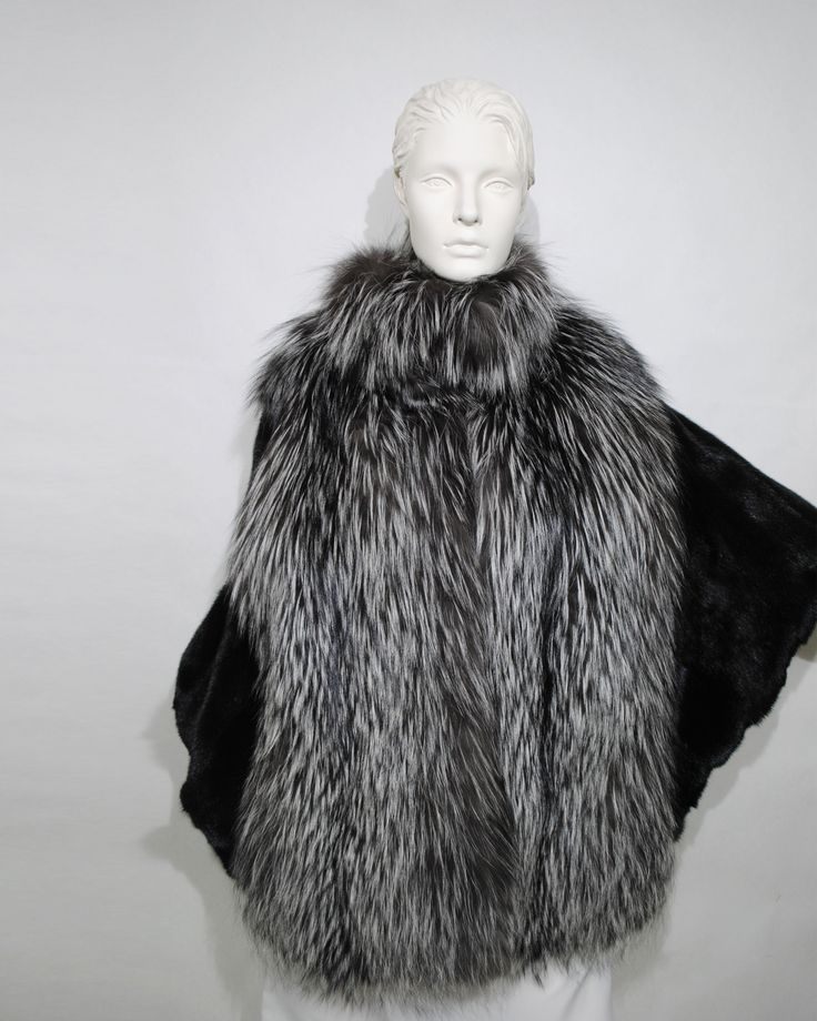 Stay warm without compromising style with this silver and black fox fur jacket.