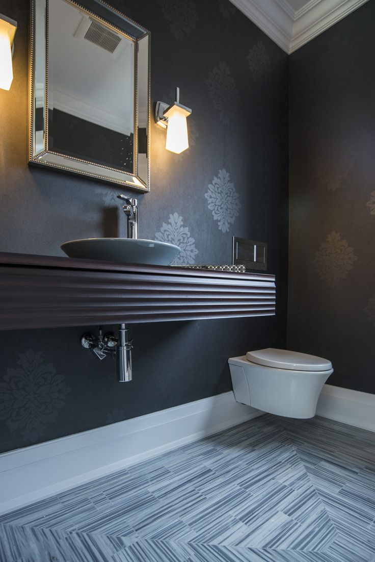 Solid wood molding blesses each and every wall of the Rondale build, and this bathroom is no exception. Thr furnishings and tile bring elegance to what you might consider a smaller space.