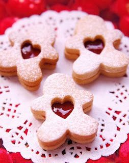 Linzer Cookies with Raspberry Jam Recipe - cute cookie shape idea for the tins. :)